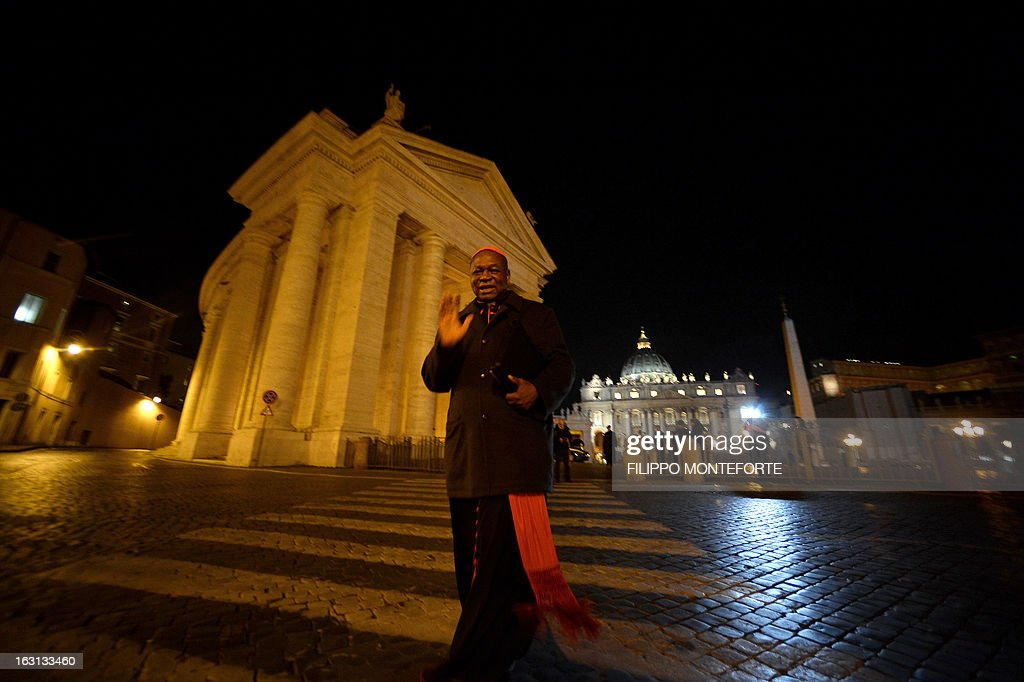 Nigerian cardinal John Onaiyekan walks after a meeting of a conclave to elect a new pope on March 4, 2013 at the Vatican. The Vatican meetings will set the date for the start of the conclave this month and help identify candidates among the cardinals to be the next leader of the world's 1.2 billion Catholics. AFP PHOTO/ Filippo MONTEFORTE