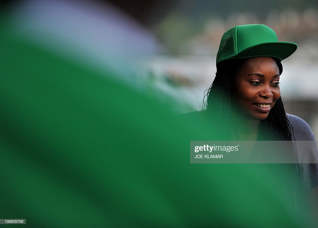 A Nigerian fan attends their friendly ma