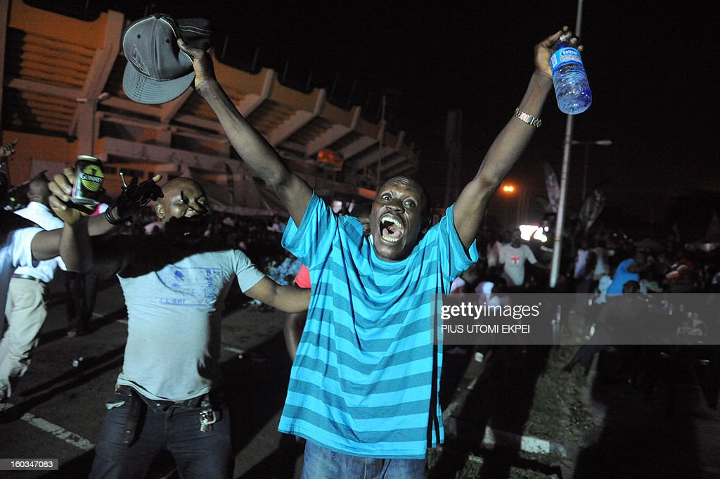 Nigerian fan celebrate a goal against Ethiopia at a public viewing centre in Lagos on January 29, 2013. Nigeria defeated Ethiopia 2-0 in Group C match played at Royal Bafokeng Stadium, Rustenburg to qualify for quater-finals of the 2013 Africa Cup of Nations in South Africa