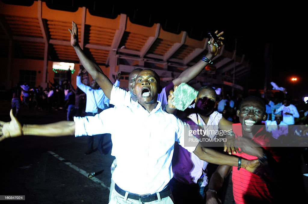 Nigerian fan celebrate goal against Ethiopia at a public viewing centre in Lagos on January 29, 2013. Nigeria defeated Ethiopia 2-0 in Group C match played at Royal Bafokeng Stadium, Rustenburg to qualify for quater-finals of the 2013 Africa Cup of Nations in South Africa AFP PHOTO/PIUS UTOMI EKPEI