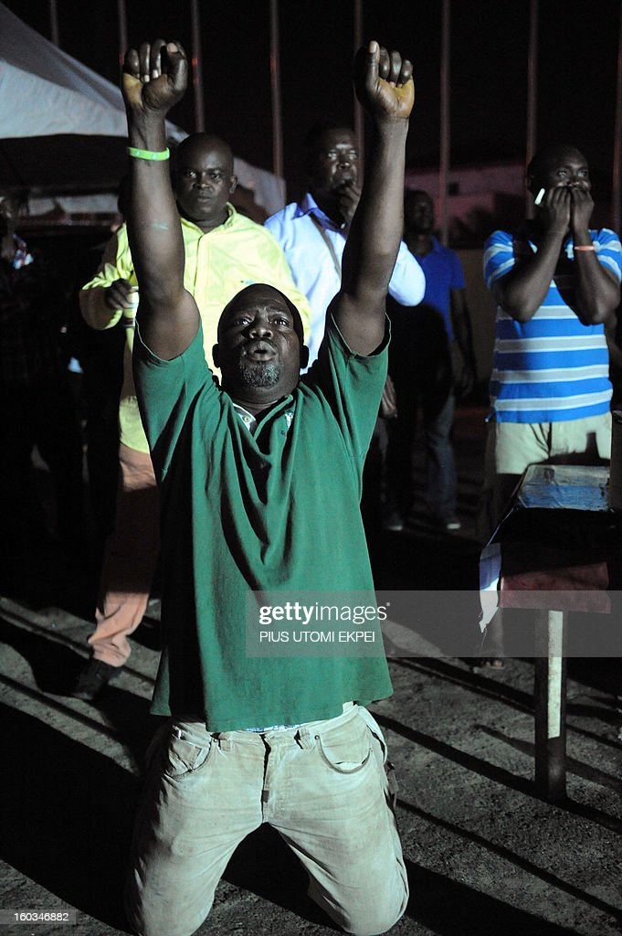 A Nigerian fan kneels to pray for goal as the country was awarded a spot kick against Ethiopia at a public viewing centre in Lagos on January 29, 2013. Nigeria defeated Ethiopia 2-0 in Group C match played at Royal Bafokeng Stadium, Rustenburg to qualify for quater-finals of the 2013 Africa Cup of Nations in South Africa AFP PHOTO/PIUS UTOMI EKPEI