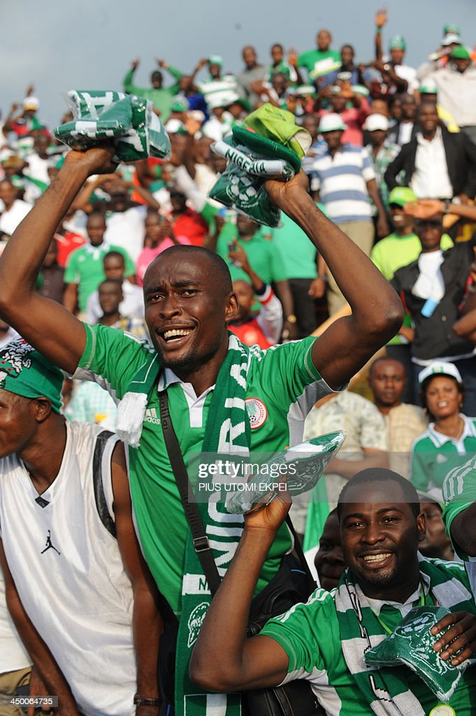 Nigerian fans celebrate a second goal against Ethiopia during the FIFA World Cup qualifier in Calabar in November 16, 2013. Nigeria defeated Ethiopia 2 - 0 in the second leg to qualify for FIFA 2014 World Cup in Brazil. AFP PHOTO/PIUS UTOMI EKPEI