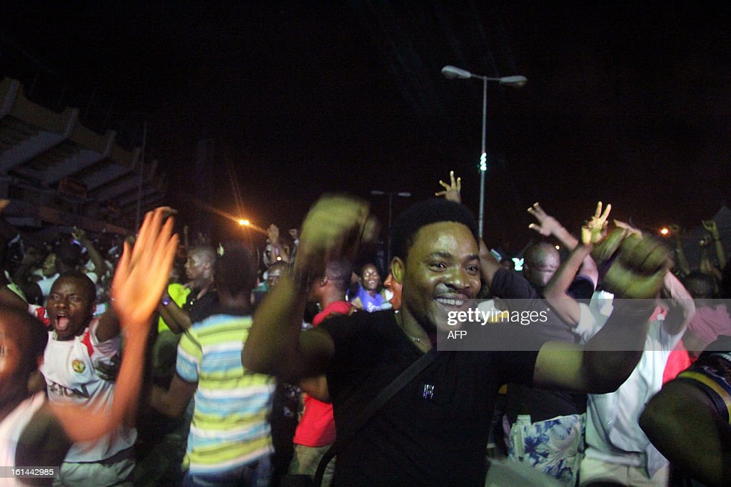 Nigerian fans celebrate their victory over Burkina-Faso at a live view centre in Lagos after the final football match on February 10, 2013. Nigeria defeated Burkina-Faso 1 - 0 to lift the trophy of the 2013 African Cup of Nations in Sun city, Johannesburg, South Africa. AFP PHOTO/EMMANUEL AREWA