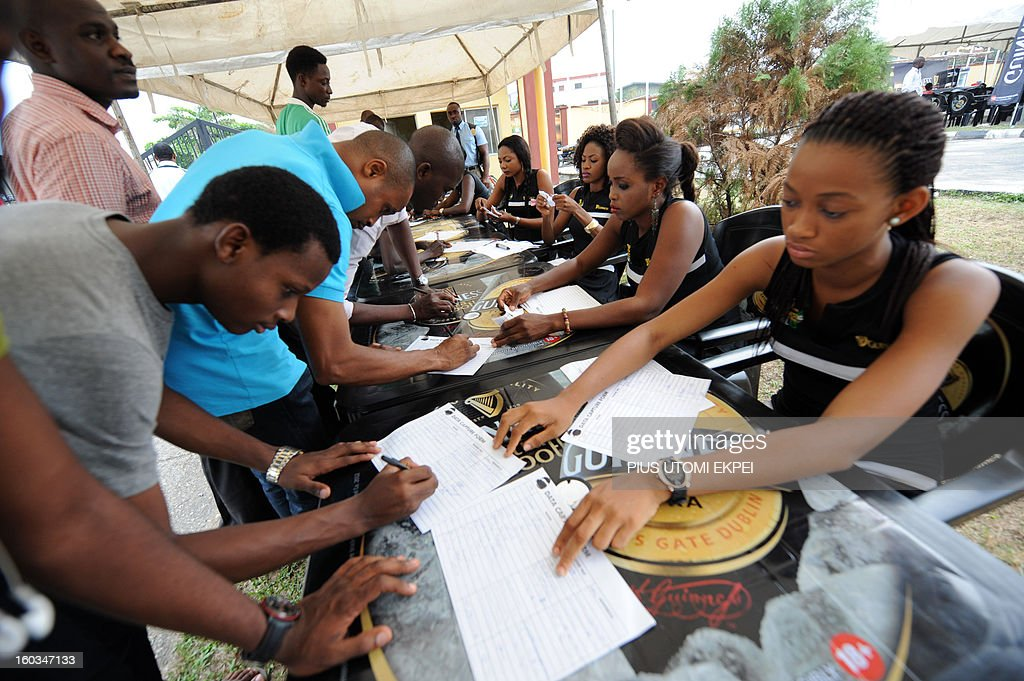 Nigerian fans fill forms to predict the winning team before Nigeria's match with Ethiopia at a public viewing centre in Lagos January 29, 2013. Nigeria defeated Ethiopia 2-0 in Group C match played at Royal Bafokeng Stadium, Rustenburg to qualify for quater-finals of the 2013 Africa Cup of Nations in South Africa