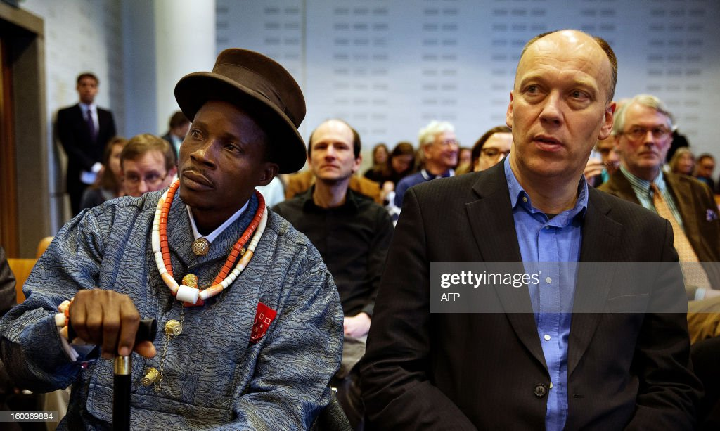 Nigerian farmer Eric Dooh (L) and Geert Ritsema (R), international campaign leader of Milieudefensie (Dutch for 'environmental defence') sit in the courthouse of The Hague, The Netherlands, on January30, 2013. Dooh is one of the Nigerian farmers who has asked the court in the Netherlands to rule that the oil company Shell is liable for poisoning their fish ponds and farmland with leaking oil pipelines. The judge said that Shell's Nigerian subsidiary must pay damages to the farmers and fishermen in one of their claims, relating to oil spills near the Niger Delta village of Ikot Ada Udo. AFP PHOTO/ JERRY LAMPEN netherlands out