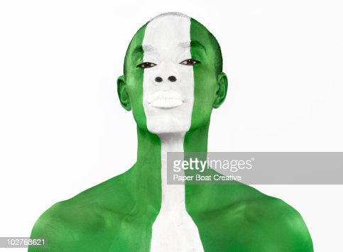 Nigerian flag painted on man's face : Stock Photo