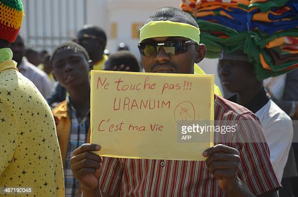 'Do not touch uranium it's my life' during a protest on February 6 2014 in Niamey as Niger's government and French nuclear giant Areva are engaged in...