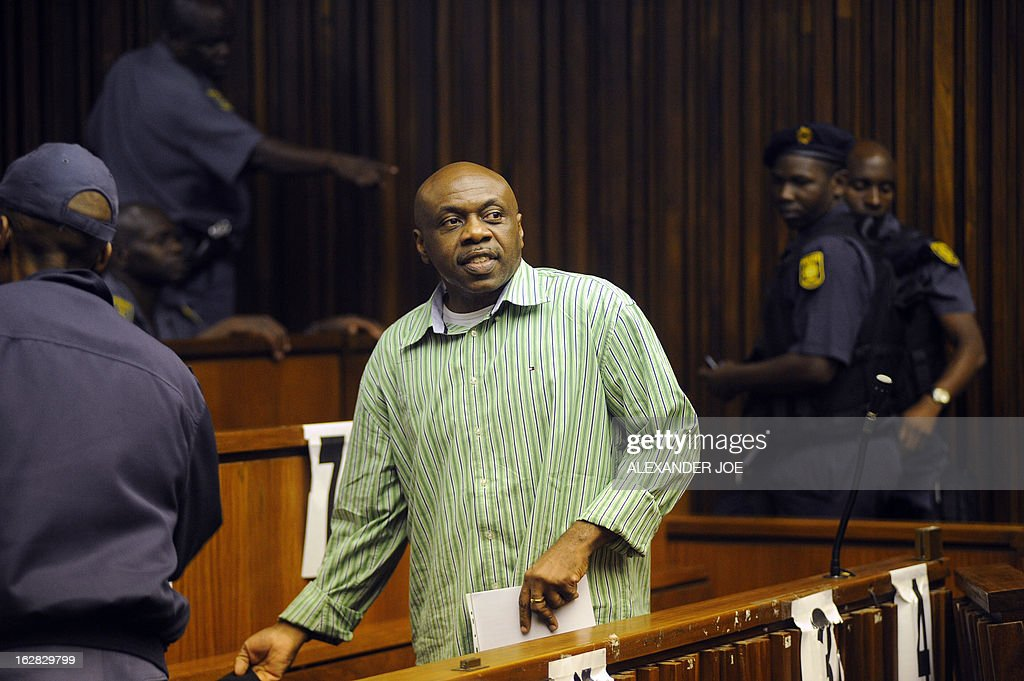 Nigerian militant leader Henry Okah is pictured after his case was posted because he changed his legal team at Johannesburg High Court on February 28, 2013. Okah is convicted of 13 terrorism charges, including the 2010 independence day bombings in Abuja. Okah was found guilty of masterminding attacks including twin car bombings in Abuja on October 1, 2010, and two explosions in March 2010 in the southern Nigerian city of Warri, a major hub of the oil-rich Delta region. He faces a minimum term of life in prison.