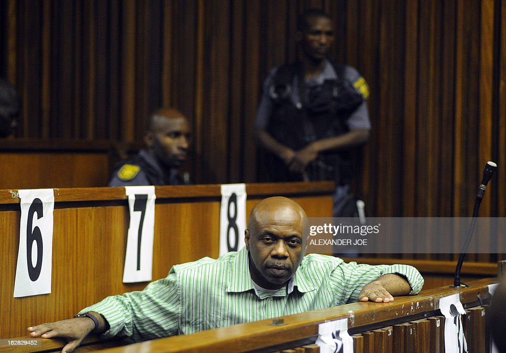 Nigerian militant leader Henry Okah is pictured in the courtroom after his case was posted because he changed his legal team at Johannesburg High Court on February 28, 2013. Okah is convicted of 13 terrorism charges, including the 2010 independence day bombings in Abuja. Okah was found guilty of masterminding attacks including twin car bombings in Abuja on October 1, 2010, and two explosions in March 2010 in the southern Nigerian city of Warri, a major hub of the oil-rich Delta region. He faces a minimum term of life in prison.