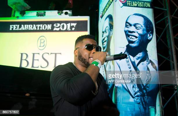 Nigerian musician Dabenja performs at the 'Afrika Shrine' dedicated to the pioneer of Afrobeat Fela Anikulapo Kuti during the annual Felabration...