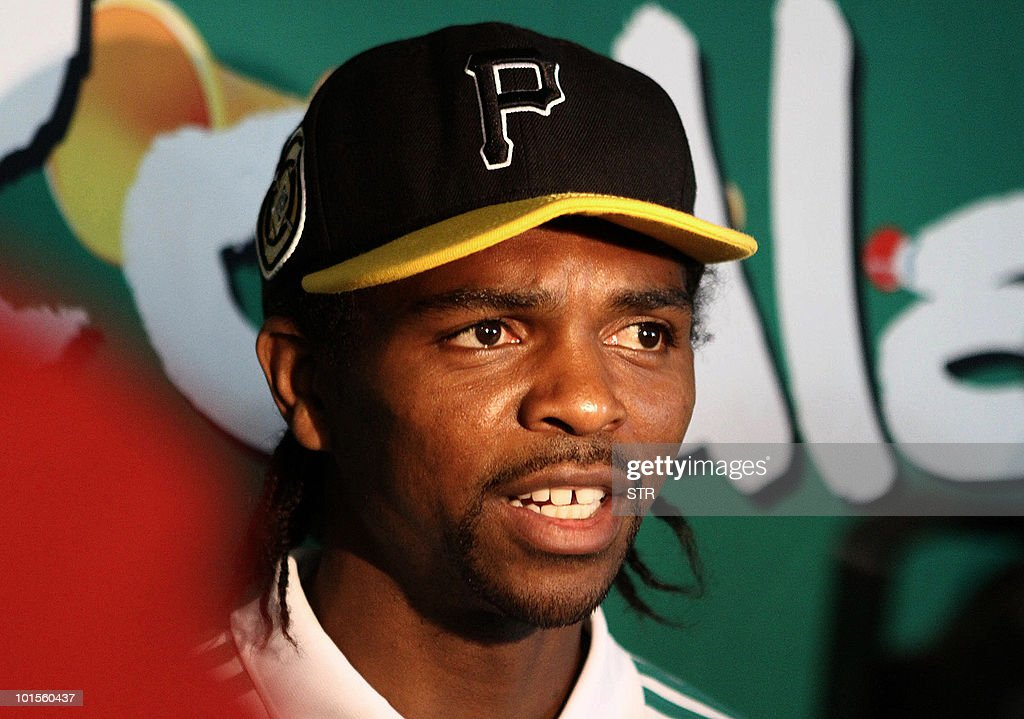 Nigerian national football team captain Nwankwo Kanu speaks to the press upon arrival in Durban on June 2, 2010 at King Shaka International Airport to take part in the Fifa World Cup 2010 football championships. After being greeted by dignitaries the team was escorted to their base hotel in Richards Bay, North of Durban. Nigeria have dropped Everton striker Victor Anichebe, but included Chelsea midfielder Mikel John Obi in their final 23-man squad for the World Cup released on May 31.
