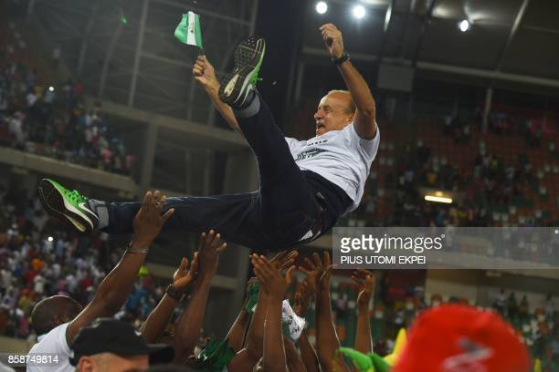 Nigerian national football team German head coach Gernot Rohr is tossed in the air by players after the FIFA World Cup 2018 qualifying football match...