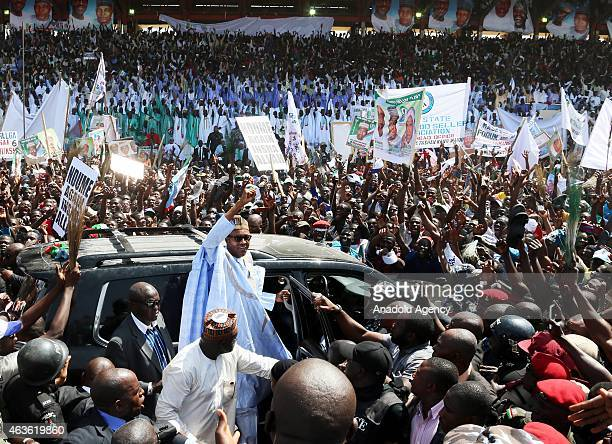 Nigerian opposition presidential candidate Muhammadu Buhari waves to his supporters as he arrives for an election campaign rally in Maiduguri Nigeria...