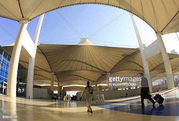Nigerian pilgrims walk outside the King Abdul Aziz airport upon their arrival to the Red Sea port city of Jeddah on November 27 2008 Muslim pilgrims...