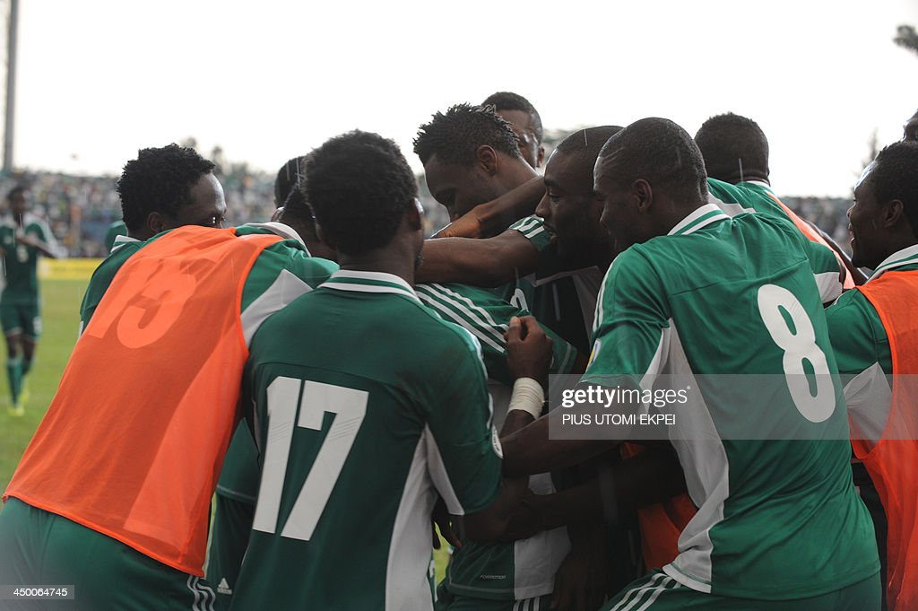 Nigerian players celebrate a second goal against Ethiopia during the FIFA World Cup qualifier in Calabar in November 16, 2013. Nigeria defeated Ethiopia 2 - 0 in the second leg to qualify for FIFA 2014 World Cup in Brazil. AFP PHOTO/PIUS UTOMI EKPEI