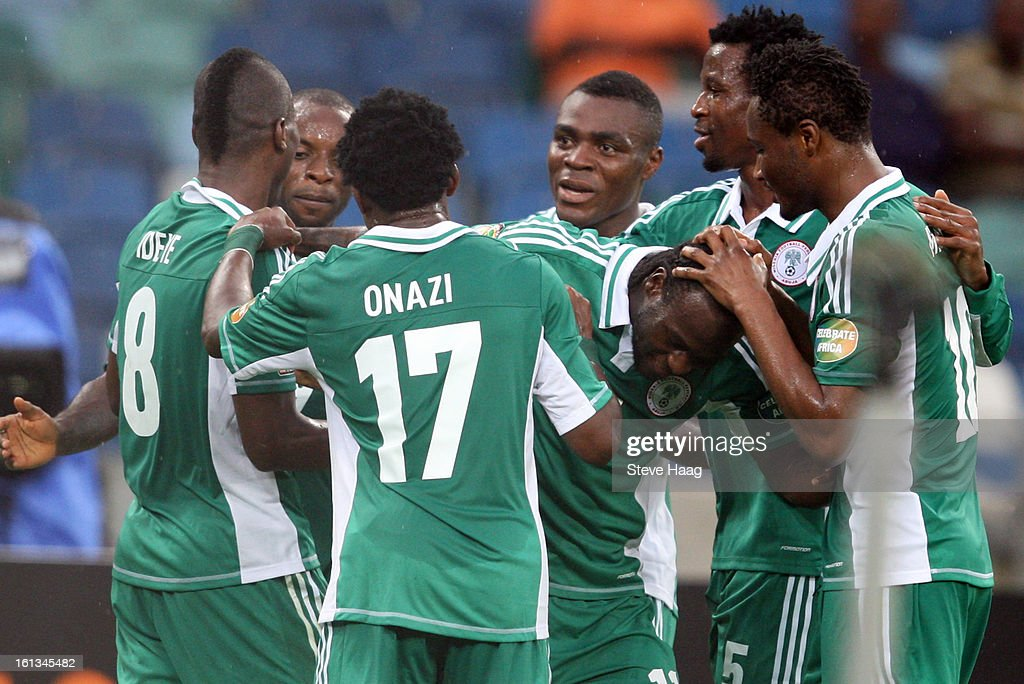 Nigerian players celebrate their team's 1st goal during the 2013 African Cup of Nations Semi-Final match between Mali and Nigeria at Moses Mahbida Stadium on February 06, 2013 in Durban, South Africa.