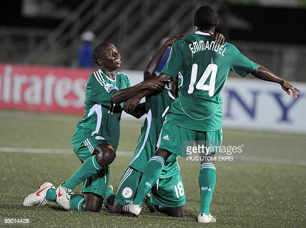 Nigerian players celebrate with teammate Sani Emmanuel after his goal against the Spain during the second semi final of FIFA U17 World Cup in Lagos...