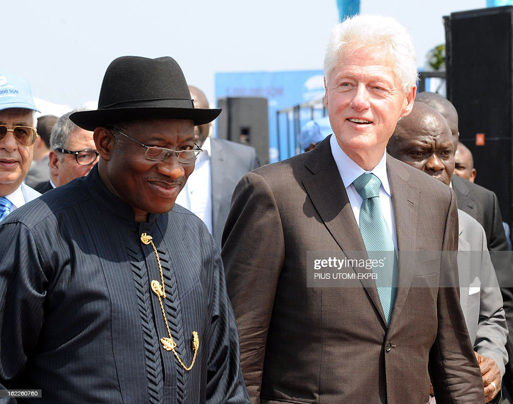 Nigerian President Goodluck Jonathan (L) and former US President Bill Clinton arrive on February 21, 2013 to attend the inauguration ceremony for the first phase of the Eko Atlantic real estate project, in Lagos, Nigeria. Eko Atlantic or Eko Atlantic City is a planned district of Lagos, Nigeria, being constructed on land reclaimed from the Atlantic Ocean. It will house some 250,000 people and be a workplace for another 150,000.