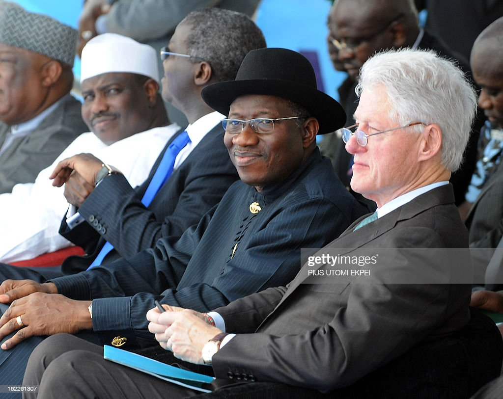 Nigerian President Goodluck Jonathan and former US President Bill Clinton speaks on February 21, 2013 during the inauguration ceremony for the first phase of the Eko Atlantic real estate project, in Lagos, Nigeria. Eko Atlantic or Eko Atlantic City is a planned district of Lagos, Nigeria, being constructed on land reclaimed from the Atlantic Ocean. It will house some 250,000 people and be a workplace for another 150,000.