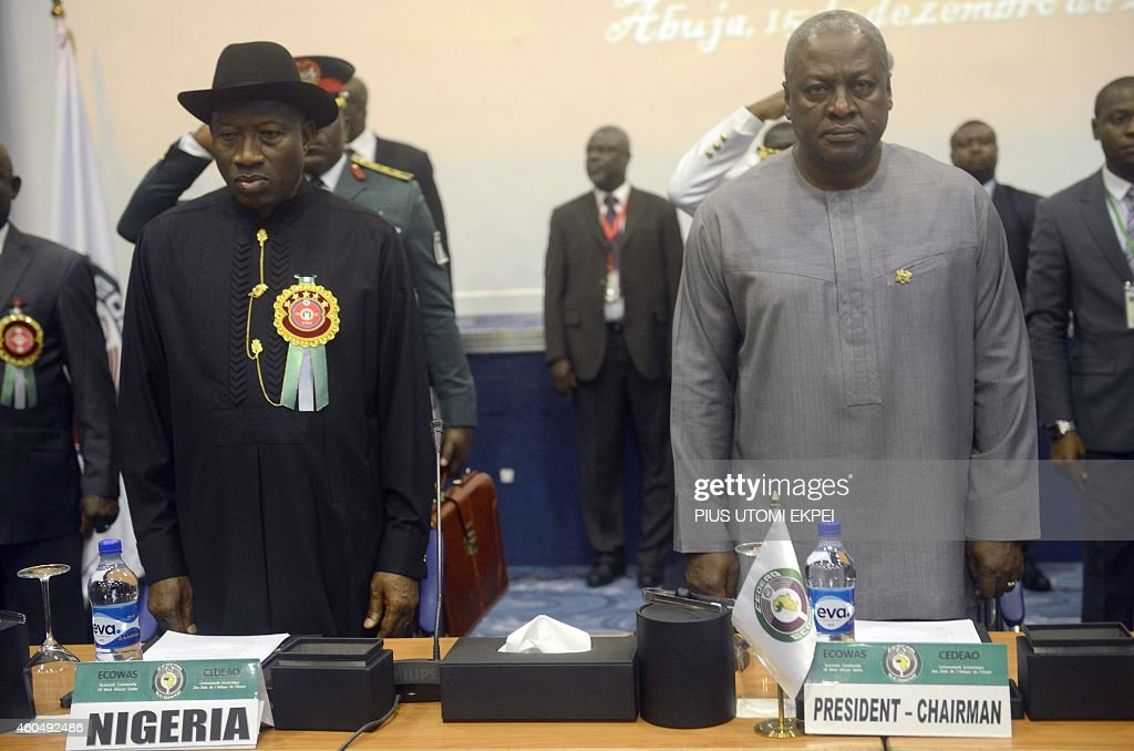 Nigerian President <a gi-track='captionPersonalityLinkClicked' href=/galleries/search?phrase=Goodluck+Jonathan&family=editorial&specificpeople=4124968 ng-click='$event.stopPropagation()'>Goodluck Jonathan</a> (L) and his Ghanaian counterpart John Mahama stands for the regional anthem during the Summit of ECOWAS Heads of state and government in Abuja on December 15, 2014. Heads of states and government of ECOWAS are meeting in Abuja to discuss the on-going fight against the deadly Ebola virus disease that is ravaging the region, as well as the political and security situation in the region.