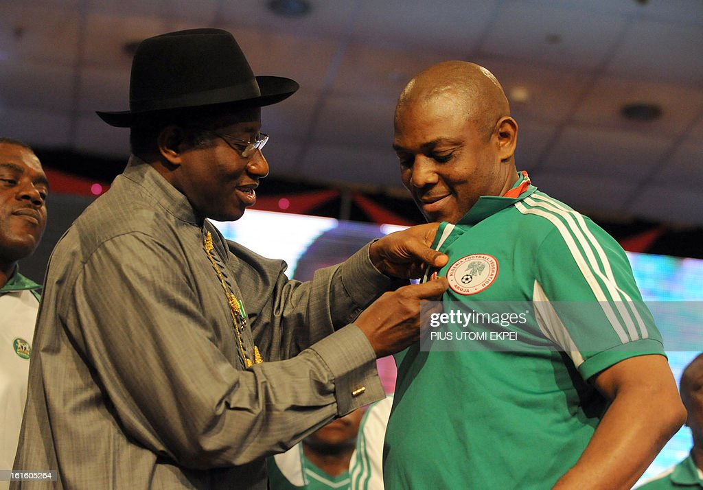Nigerian President Goodluck Jonathan decorates the national football Coach Stephen Keshi (R) with a national award during the presidential banquet in honour of the victorious team in Abuja February 12, 2013. The newly crowned African champions Nigerian Super Eagles arrives in Abuja to a warm reception by fans and government officials after defeating Burkina Faso to win the 2013 African Cup of Nations in South Africa.