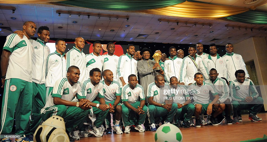 Nigerian President Goodluck Jonathan holds the trophy poses with the victorious national football team at the 2013 African Cup of Nations during the presidential banquet in honour of the team in Abuja February 12, 2013. The newly crowned African champions Nigerian Super Eagles arrives in Abuja to a warm reception by fans and government officials after defeating Burkina Faso to win the 2013 African Cup of Nations in South Africa.