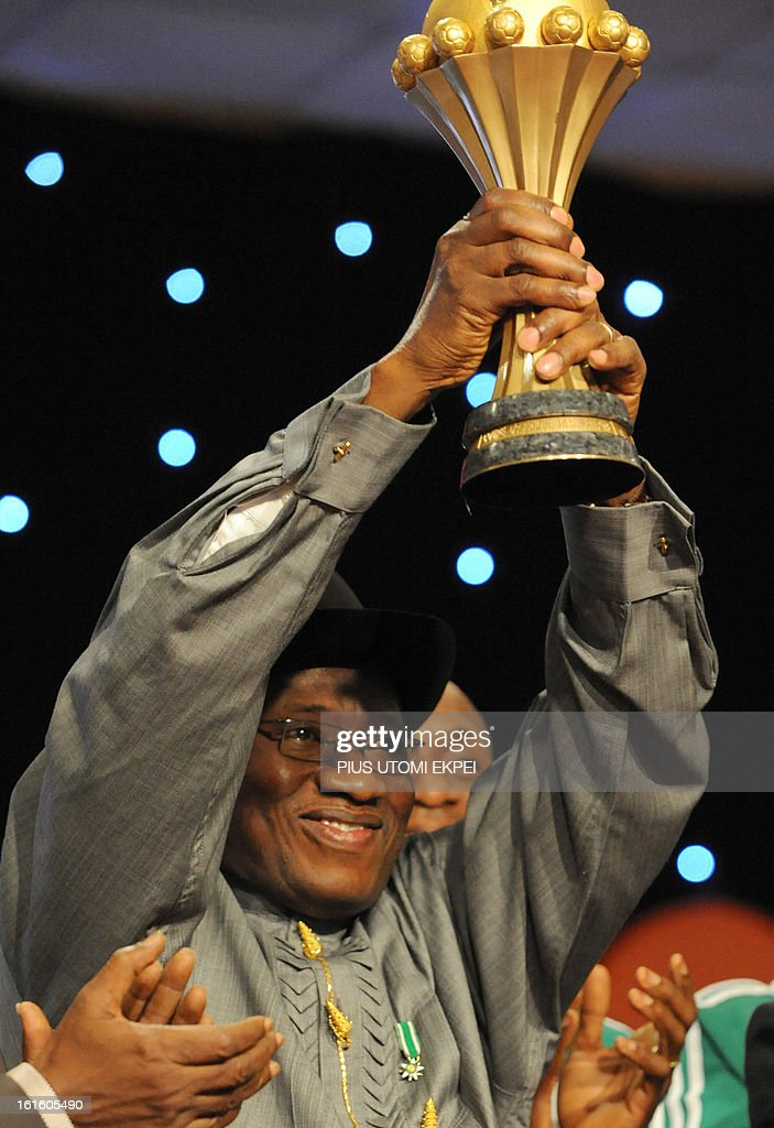 Nigerian President Goodluck Jonathan raises the 2013 African Cup of Nations trophy won by the country's national football team during the presidential banquet in honour of the victorious team in Abuja February 12, 2013. The newly crowned African champions Nigerian Super Eagles arrives in Abuja to a warm reception by fans and government officials after defeating Burkina Faso to win the 2013 African Cup of Nations in South Africa.