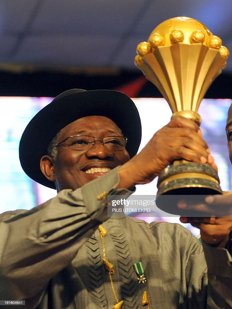Nigerian President Goodluck Jonathan raises the trophy won by the national football team at the 2013 African Cup of Nations during the presidential banquet in honour of the victorious team in Abuja February 12, 2013. The newly crowned African champions Nigerian Super Eagles arrives in Abuja to a warm reception by fans and government officials after defeating Burkina Faso to win the 2013 African Cup of Nations in South Africa.