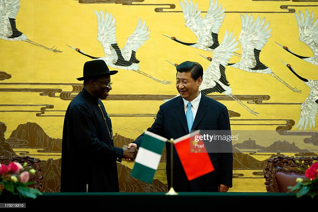 Nigerian President <a gi-track='captionPersonalityLinkClicked' href=/galleries/search?phrase=Goodluck+Jonathan&family=editorial&specificpeople=4124968 ng-click='$event.stopPropagation()'>Goodluck Jonathan</a> shakes hands with Chinese President <a gi-track='captionPersonalityLinkClicked' href=/galleries/search?phrase=Xi+Jinping&family=editorial&specificpeople=2598986 ng-click='$event.stopPropagation()'>Xi Jinping</a>, (R) after the two country's ministers signed several agreements during a signing ceremony at the Great Hall of the People in Beijing, China, Wednesday, July 10, 2013. The Nigerian president was in China to finalise low interest loans to help with Nigeria's infrastructure.