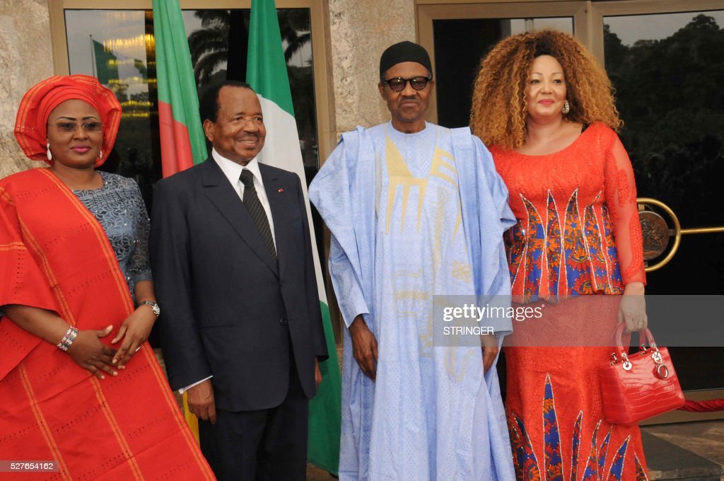 Nigerian President Mohammadu Buhari (2nd R) and his Cameroonian counterpart Paul Biya pose with their wives Chantal Biya (R) and Aisha Buhari (L) at the presidential Villa in Abuja, on May 3, 2016. Cameroonian President Paul Biya arrived accompanied by wife Chantal and senior government officials for a two-day state visit to Nigeria. / AFP / STRINGER