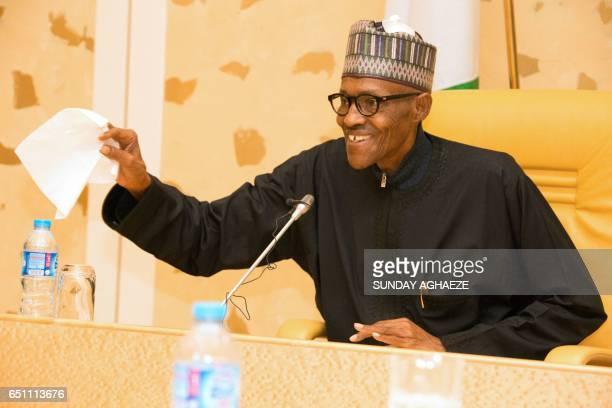 Nigerian President Muhammadu Buhari addresses members of his cabinet upon his arrival at the presidency in Abuja on March 10 2017 President Muhammadu...