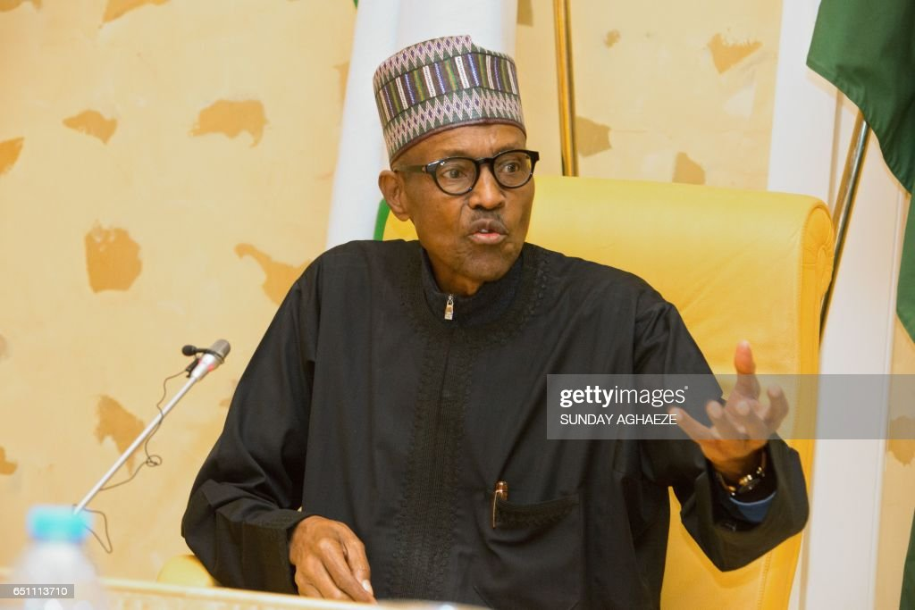 Nigerian President Muhammadu Buhari addresses members of his cabinet upon his arrival at the presidency in Abuja, on March 10, 2017. President Muhammadu Buhari arrived back in Nigeria on Friday after nearly two months in London receiving treatment for an undisclosed ailment. / AFP PHOTO / Sunday AGHAEZE
