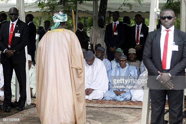 Nigerian president Muhammadu Buhari are seen at Abuja National Mosque during the prayer on July 17 to observe the Eid alFitr the threeday festival...