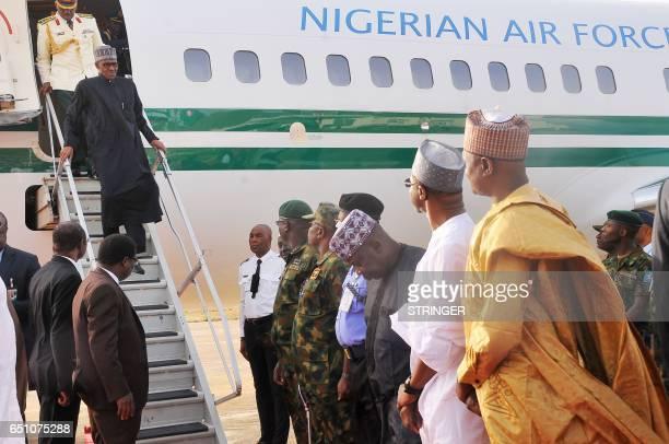 Nigerian President Muhammadu Buhari disembarks from an aircraft upon his arrival at the Nigerian Airforce base in Kaduna on March 10 2017 Buhari...