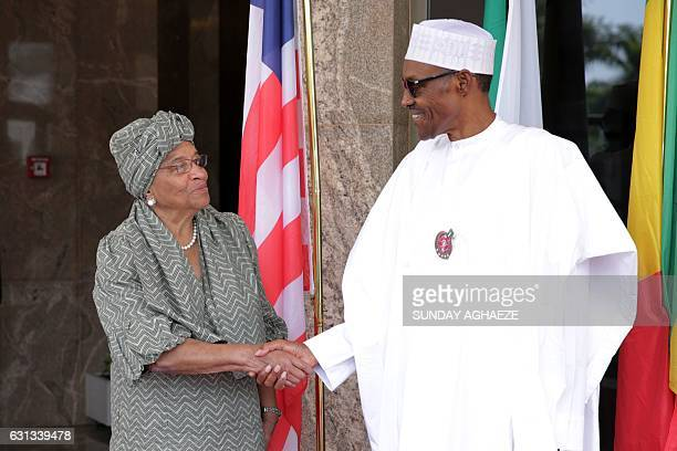 Nigerian President Muhammadu Buhari greets President of Liberia Ellen Johnson Sirleaf in Abuja on January 9 before a meeting on the political...