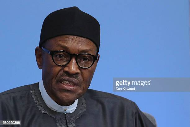 Nigerian President Muhammadu Buhari speaks after British Prime Minister Cameron opened the international anticorruption summit on May 12 2016 in...