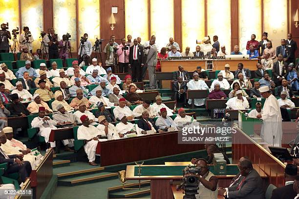 Nigerian President Muhammadu Buhari speaks to members of the National Assembly after submiting his budget for 2016 in Abuja on December 22 2015...