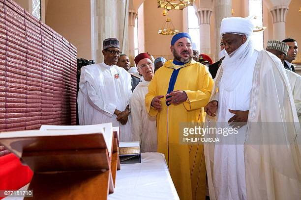 Nigerian President Muhammadu Buhari stands by King of Morocco Mohammed VI as he speaks with Sultan of Sokoto Muhammadu Saad Abubakar III after...