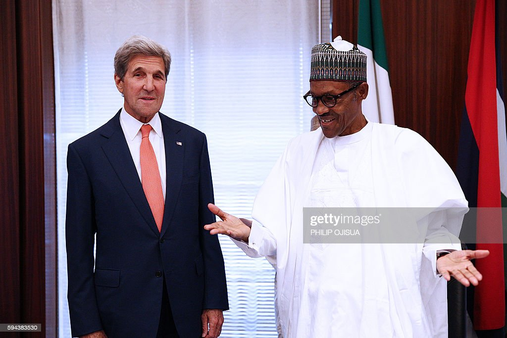 Nigerian President Muhammadu Buhari welcomes US Secretary of State John Kerry upon his arrival at the Presidential villa in the Nigerian capital of...
