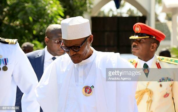 Nigerian President Muhammed Buhari arrives to attend a meeting with coalition members to find a solution to political crisis after Gambian...