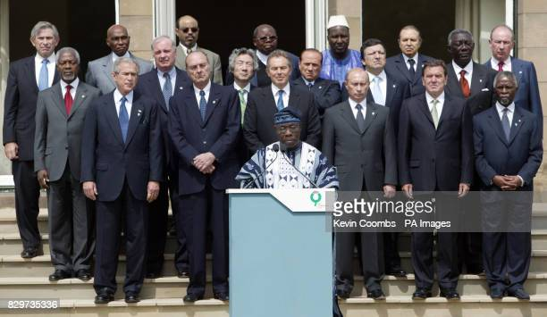 Nigerian President Olusegun Obasanjo makes a statement in front of G8 and African leaders at the end of the G8 summit in Gleneagles Front row L to R...