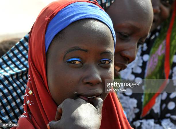 Nigerian refugee young girl looks on in a United Nations Refugee Agency refugee camp in Baga Sola by Lake Chad which borders Chad Nigeria Niger and...