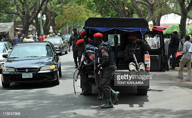 Nigerian security operatives move to secure a polling station following fears of ballot boxsnatching during gubernatorial elections on April 28 in...