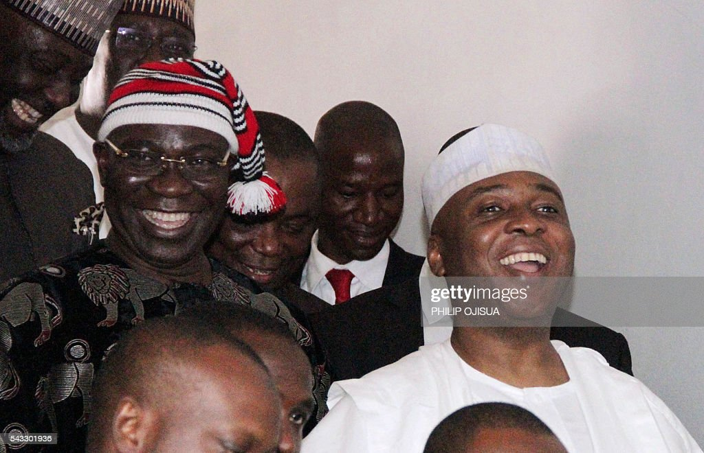 Nigerian Senate president Bukola Saraki (R) and his deputy Ike Ekweremadu (L) leave the courtroom after being charged with falsifying parliamentary rules to get elected in Abuja, on June 27, 2016. Nigerian Senate president Bukola Saraki on June 27, 2016 kicked off his corruption trial by denying he falsified parliamentary rules to get elected. The influential Nigerian politician has been charged with two counts of criminal conspiracy and forgery and was in the dock alongside his deputy, Ike Ekweremadu, at the high court in Abuja. OJISUA