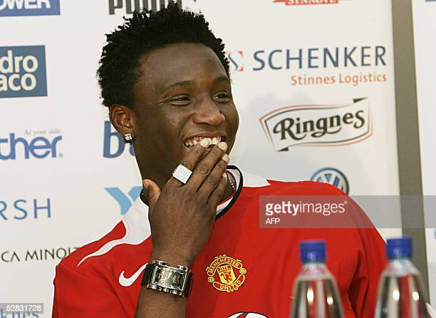 Nigerian soccer player John Obi Mikel smiles after signing with Manchester United in Oslo 29 April 2005 Mikel who signed for Manchester United has...