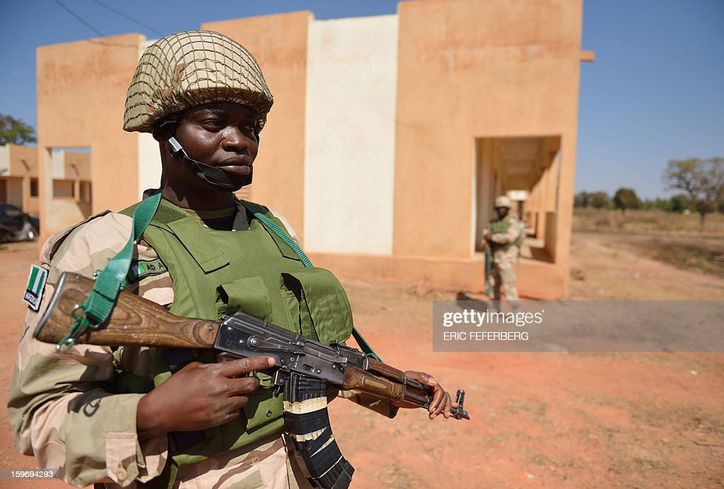 A Nigerian soldier guards residential quarters at the Malian army 101 airbase, where French troops are also stationed, on January 18, 2013, near Bamako. France now has 1,800 troops on the ground in Mali, inching closer to the goal of 2,500 it plans to deploy in its African former colony, Defence Minister Jean-Yves Le Drian said today. That was 400 more than a day earlier, said the minister as he met with French special forces in the western port of Lorient. The troops have been sent to help the Malian army regain control of the north from Islamist groups. AFP PHOTO / ERIC FEFERBERG
