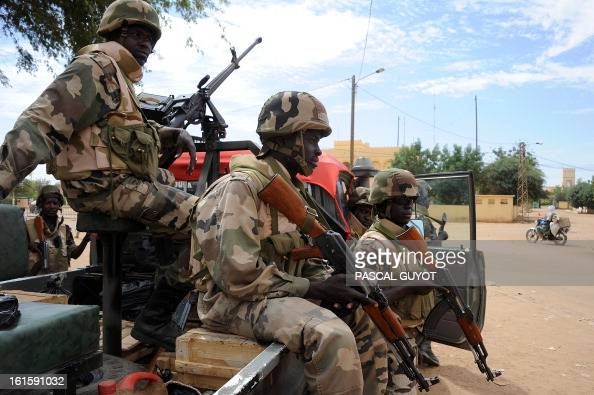 Nigerian soldiers guard a crossroads on February 12 2013 in the center of the northern Malian city of Gao where the militant group Movement for...