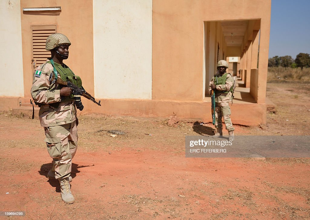 Nigerian soldiers guard residential quarters at the Malian army 101 airbase, where French troops are also stationed, on January 18, 2013, near Bamako. France now has 1,800 troops on the ground in Mali, inching closer to the goal of 2,500 it plans to deploy in its African former colony, Defence Minister Jean-Yves Le Drian said today. That was 400 more than a day earlier, said the minister as he met with French special forces in the western port of Lorient. The troops have been sent to help the Malian army regain control of the north from Islamist groups.