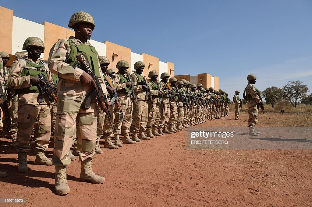 Nigerian soldiers part of Economic Community of West African States (ECOWAS) troops train on January 19, 2013 on the 101st airbase in Bamako. Ivorian President Alassane Ouattara on January 19 called for a broader international commitment to the military operations in Mali, where Malian and French forces are battling Islamist militant groups that control the country's vast arid north. Some 2,000 members of MISMA (the International Mission for Mali Assistance), the African intervention force, are expected to be deployed by January 26. About 100 soldiers from Togo and Nigeria have already arrived in Bamako, and another 30 or so from Benin are en route to join them.