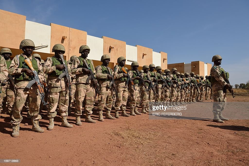 Nigerian soldiers part of Economic Community of West African States (ECOWAS) troops train on January 19, 2013 on the 101st airbase in Bamako. Ivorian President Alassane Ouattara on January 19 called for a broader international commitment to the military operations in Mali, where Malian and French forces are battling Islamist militant groups that control the country's vast arid north. Some 2,000 members of MISMA (the International Mission for Mali Assistance), the African intervention force, are expected to be deployed by January 26. About 100 soldiers from Togo and Nigeria have already arrived in Bamako, and another 30 or so from Benin are en route to join them. AFP PHOTO / ERIC FEFERBERG